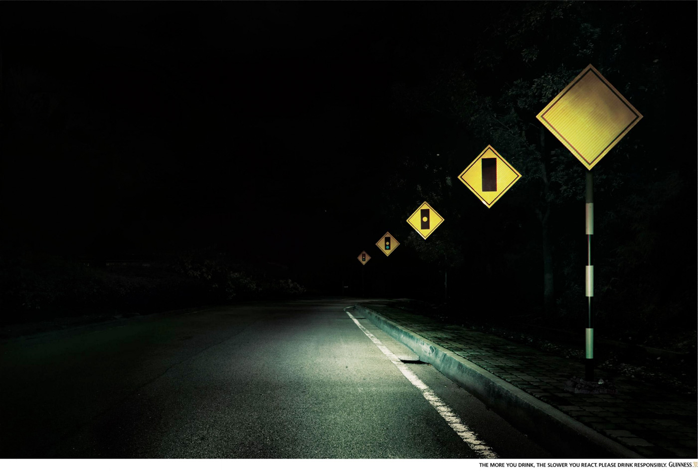 Guinness Outdoor Advert By Saatchi  for Traffic Light On Road At Night  157uhy