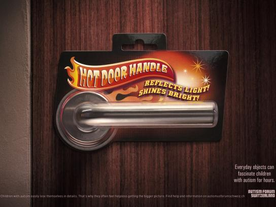 Autism Forum Switzerland Print Ad - Hot Door Handle