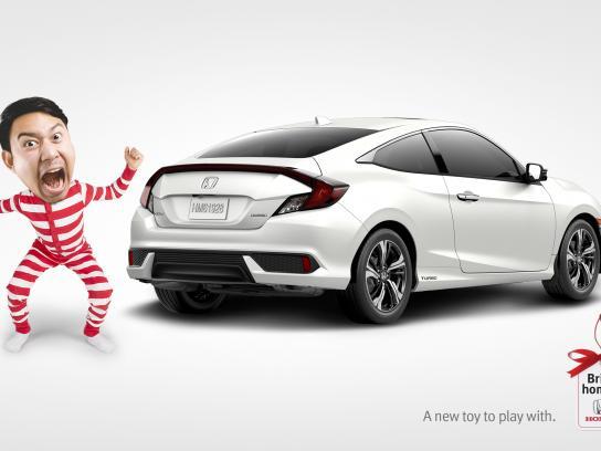 Honda Print Ad - Bring home a Honda - Toy