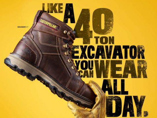 Cat Footwear Print Ad - A 40 Ton Excavator