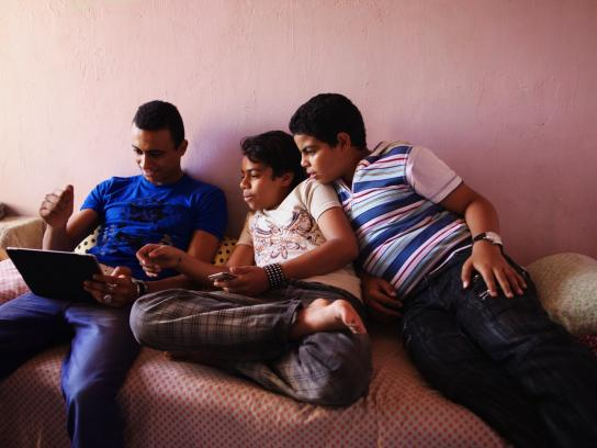 Egyptian boys playing with electronic toys