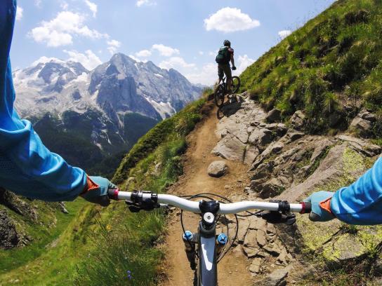 Two men mountain biking, Dolomites, Italy
