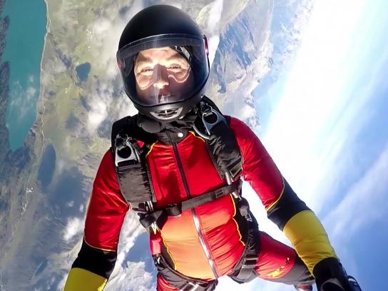 Portrait of female skydiver in mid air flight
