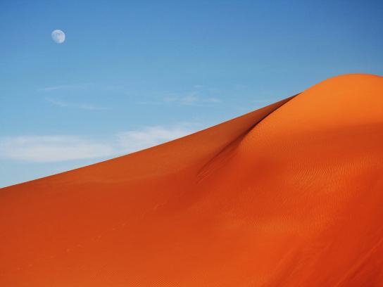 Moon, sun, and sand