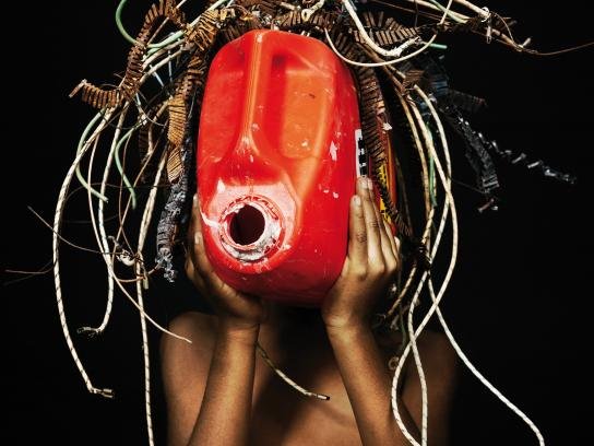 Greenpeace Africa Print Ad - African Trash Masks, Red
