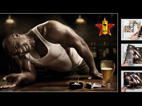 Dark Dog Print Ad -  Arm wrestling