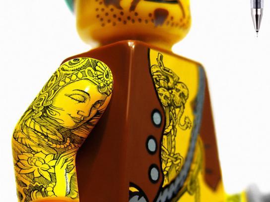 Pilot Print Ad -  Legoman tattoo, arms