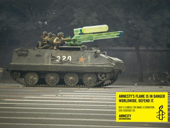 Amnesty International Print Ad -  Amnesty's flame is in danger worldwide, Asia