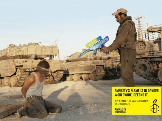 Amnesty International Print Ad -  Amnesty's flame is in danger worldwide, Middle-East