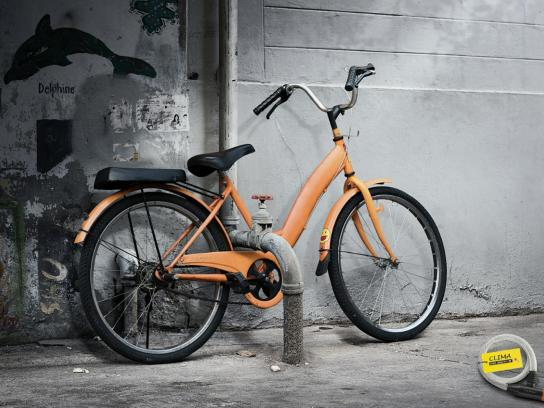 Clima Bicycle Lock Print Ad -  Orange