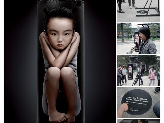 Save the Children Ambient Ad -  Only cowards beat their child
