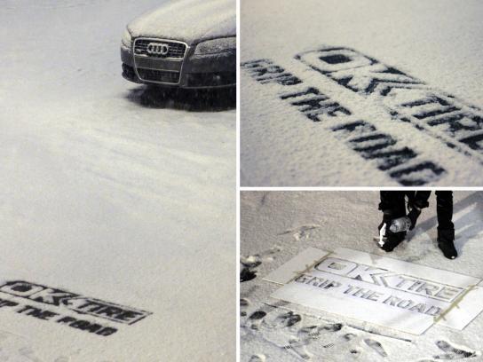 OK Tire Ambient Ad -  Snow Logo