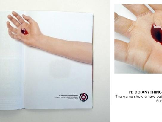 TV6 Ambient Ad -  Pierced hand