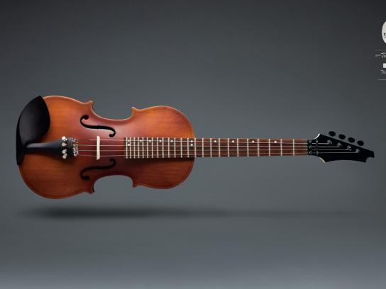 Karmaturk Print Ad -  Violin/Bass Guitar
