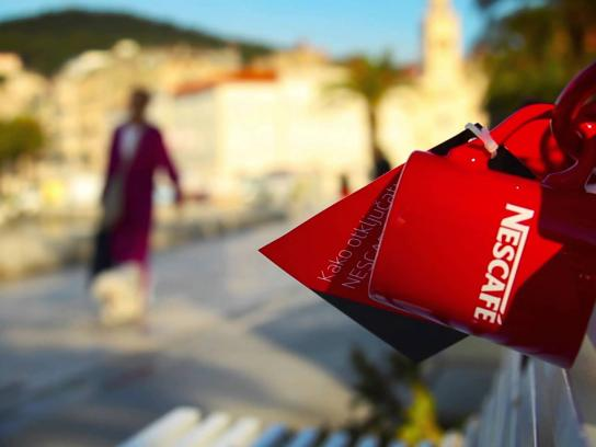Nescafe Ambient Ad -  A thousand red mugs