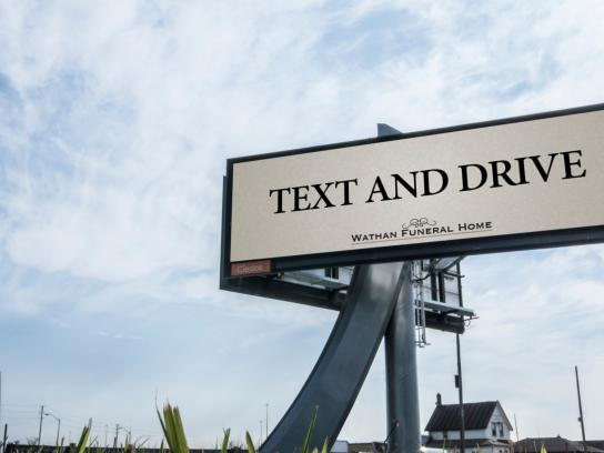 Wathan Funeral Home Outdoor Ad - Text and Drive