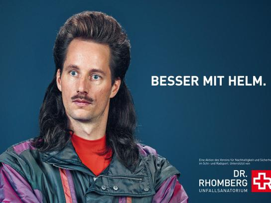 Dr. Rhomberg Medical Centre Outdoor Ad -  Better with a helmet, 1