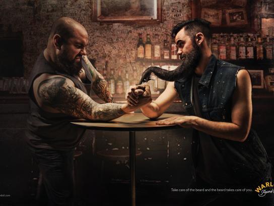 Warlord Beard Oil Print Ad - Arm wrestling