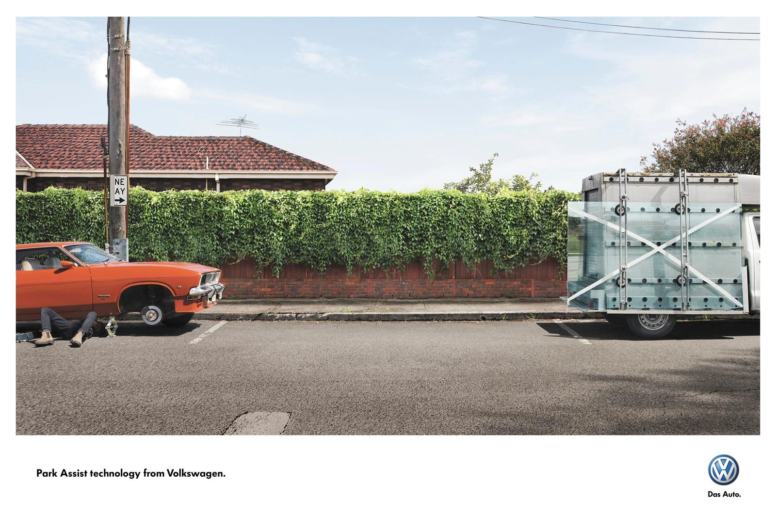 Volkswagen Print Ad -  Park Assist Technology, Car Jack-Glass Truck