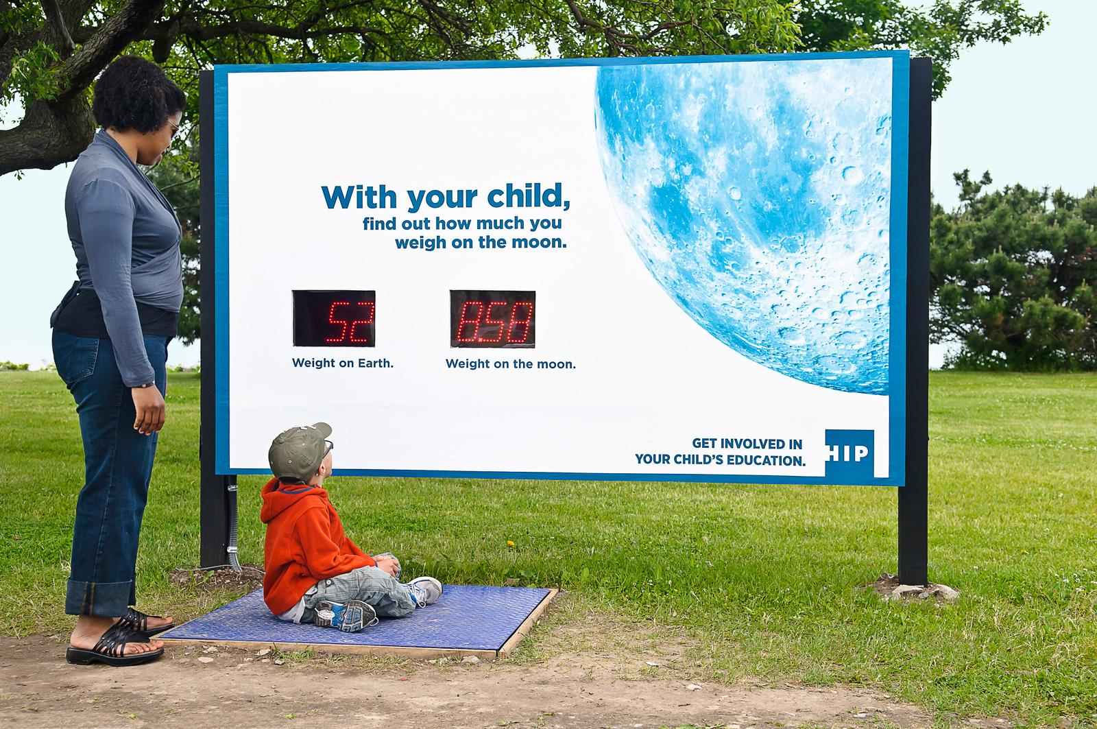 HIP Outdoor Ad -  Sign weight on moon