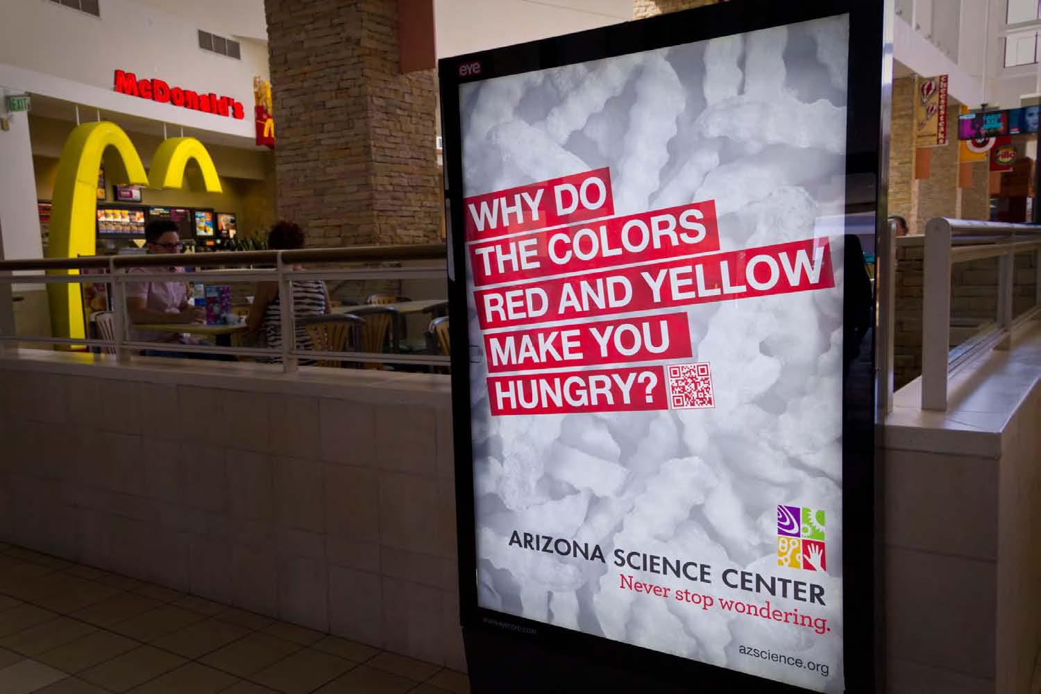 Arizona Science Center Outdoor Ad -  Never stop wondering, Yellow Red Hungry