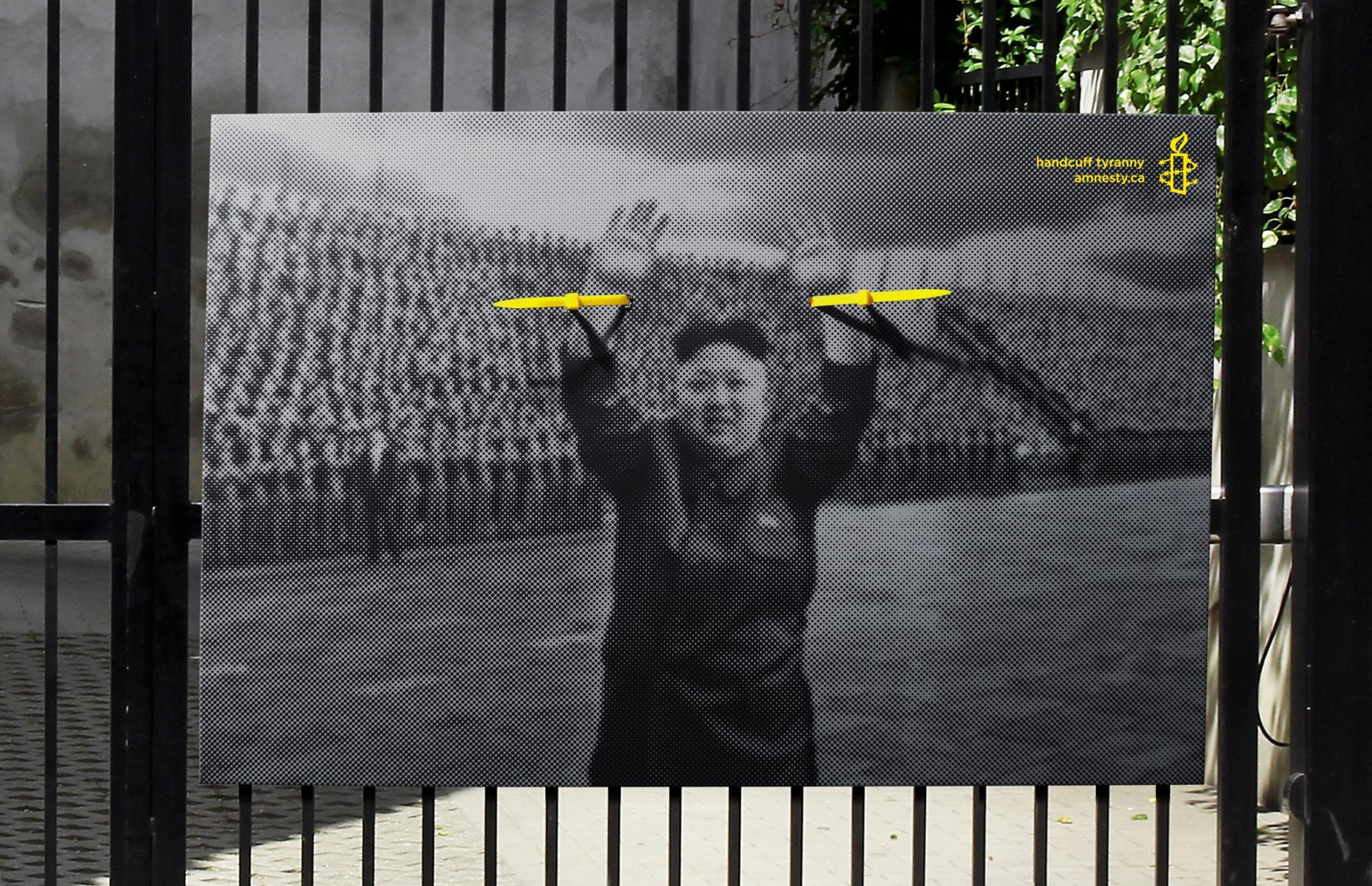 Amnesty International Outdoor Ad -  Handcuff tyranny, 1